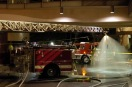 Photo by Sarah Baker - LA firefighters assist in decontamination efforts during a terrorism exercise at Northridge mall on Sunday.  08.03.03