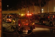 "Photo by Sarah Baker - Fire engines wait as their inhabitants work to ""save"" victims of a simulated terrorist attack at Northridge Fashion Center on Sunday.  08.03.03"