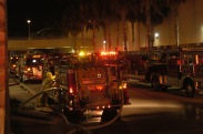 """Photo by Sarah Baker - Fire engines wait as their inhabitants work to """"save"""" victims of a simulated terrorist attack at Northridge Fashion Center on Sunday.  08.03.03"""